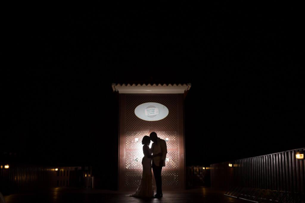bride groom silhouette embrace pine cliffs resort portugal oxford destination wedding photographer