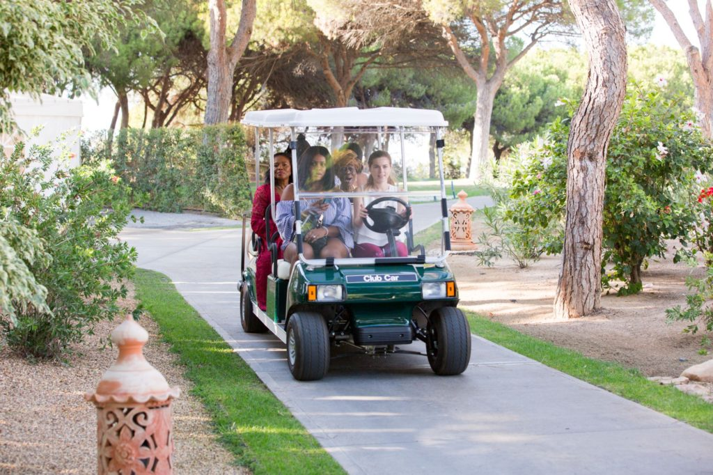 bridal party in golf buggy pine cliffs resort portugal oxfordshire wedding photography