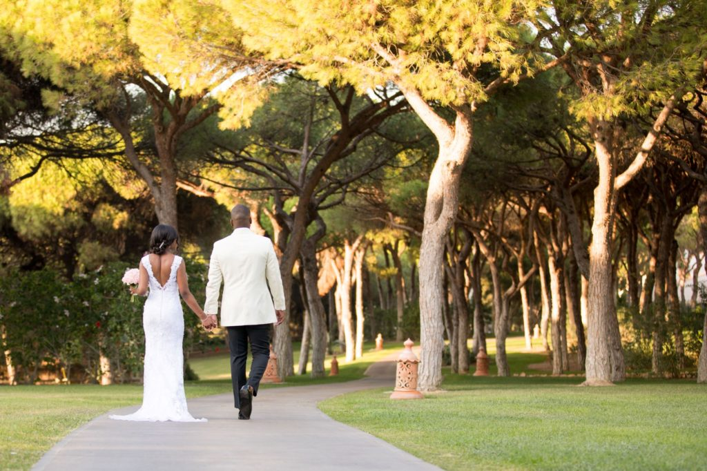 bride groom stroll in pine cliffs resort gardens portugal oxfordshire wedding photography