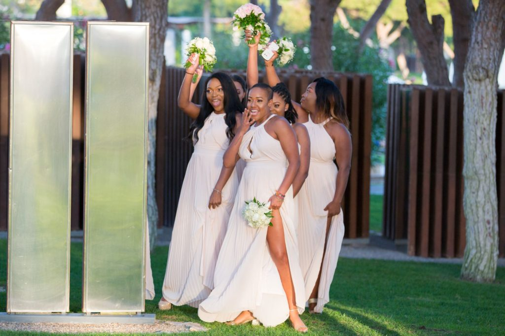 dancing bridesmaids with bouquets pine cliffs resort portugal oxford wedding photography