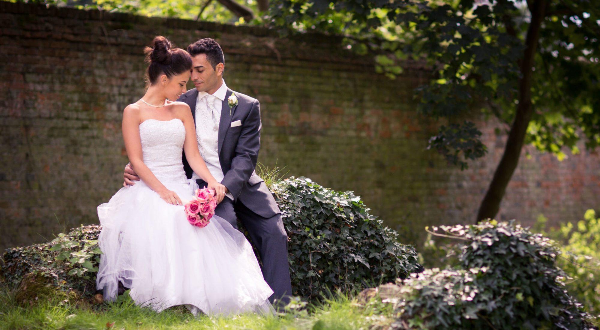 groom embraces bride buckinghamshire garden oxfordshire wedding photographer