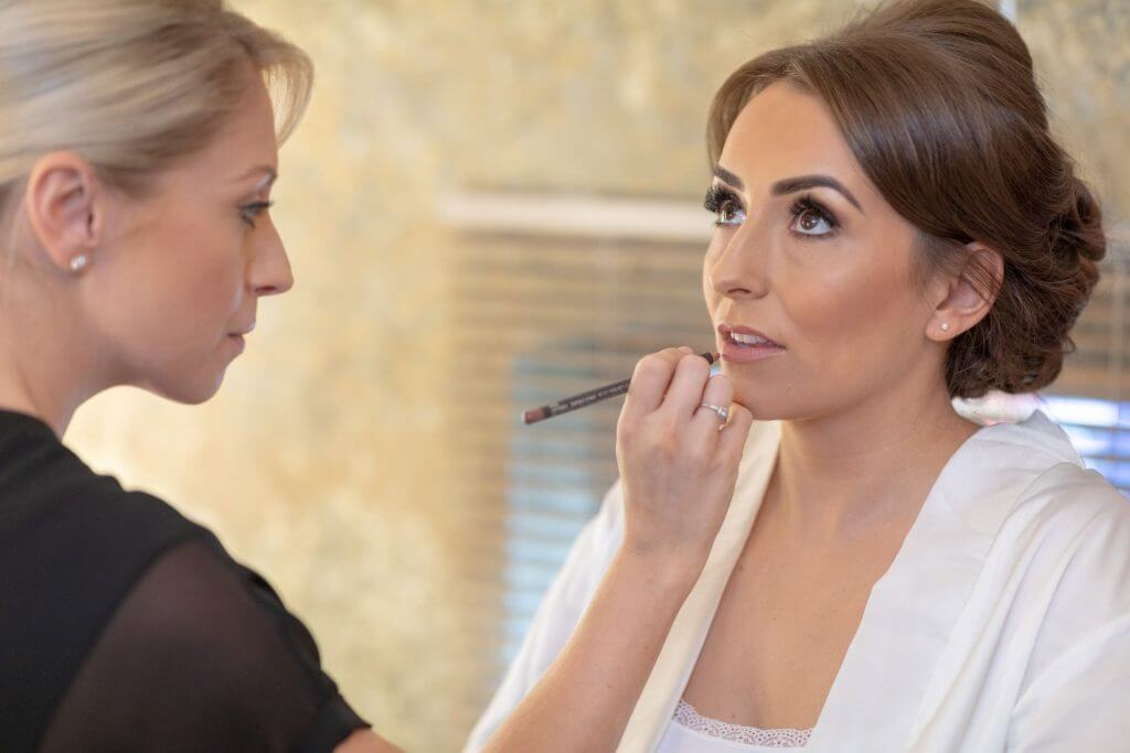 01 bride preparation makeup Mythe Barn luxury venue leicestershire oxfordshire wedding photography