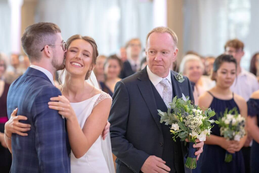 02 bride father and groom at alter marriage ceremony st marys church bryanston square marylebone london oxford wedding photographer