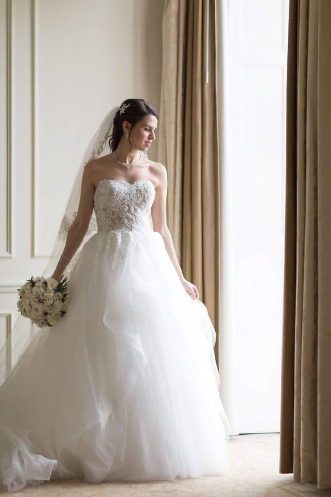 02 bride preparation beautiful dress portrait four seasons hotel venue hampshire oxford wedding photographer
