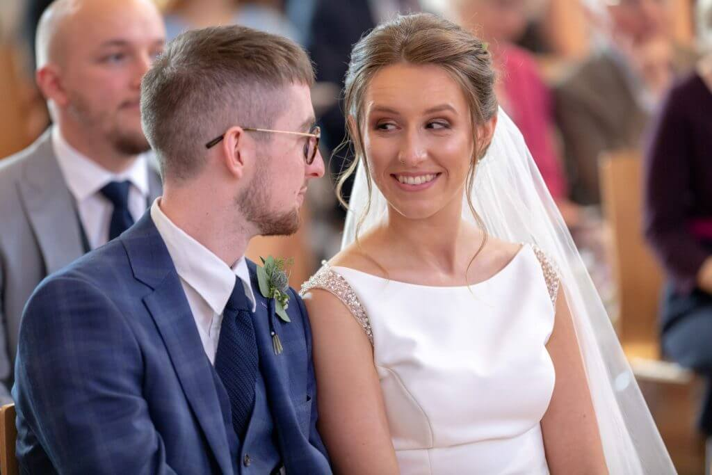 03 bride and groom exchange glances marriage ceremony st marys church bryanston square marylebone london oxford wedding photography