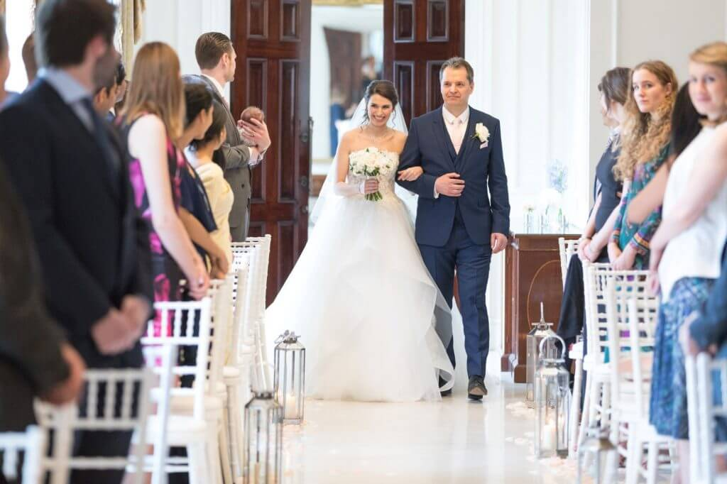 03 father of the bride walks daughter down aisle luxury four seasons hotel hampshire venue oxfordshire wedding photography