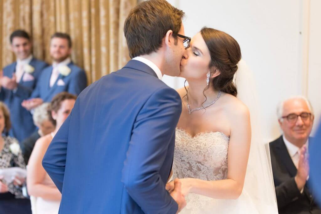04 bride groom first kiss marriage ceremony luxury four seasons hotel venue hampshire oxford wedding photographer