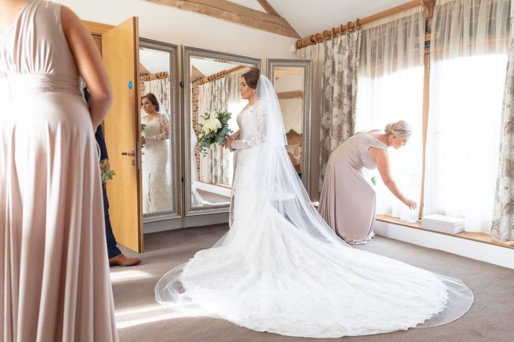 04 bride preparation dress flowers bouquet bridesmaids mythe barn luxury venue leicestershire oxfordshire wedding photography