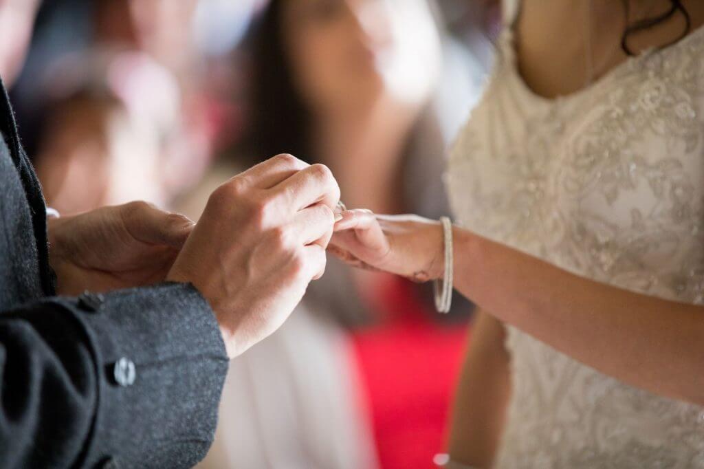 05 bride groom exchange rings marriage ceremony stoneleigh abbey kenilworth warwickshire