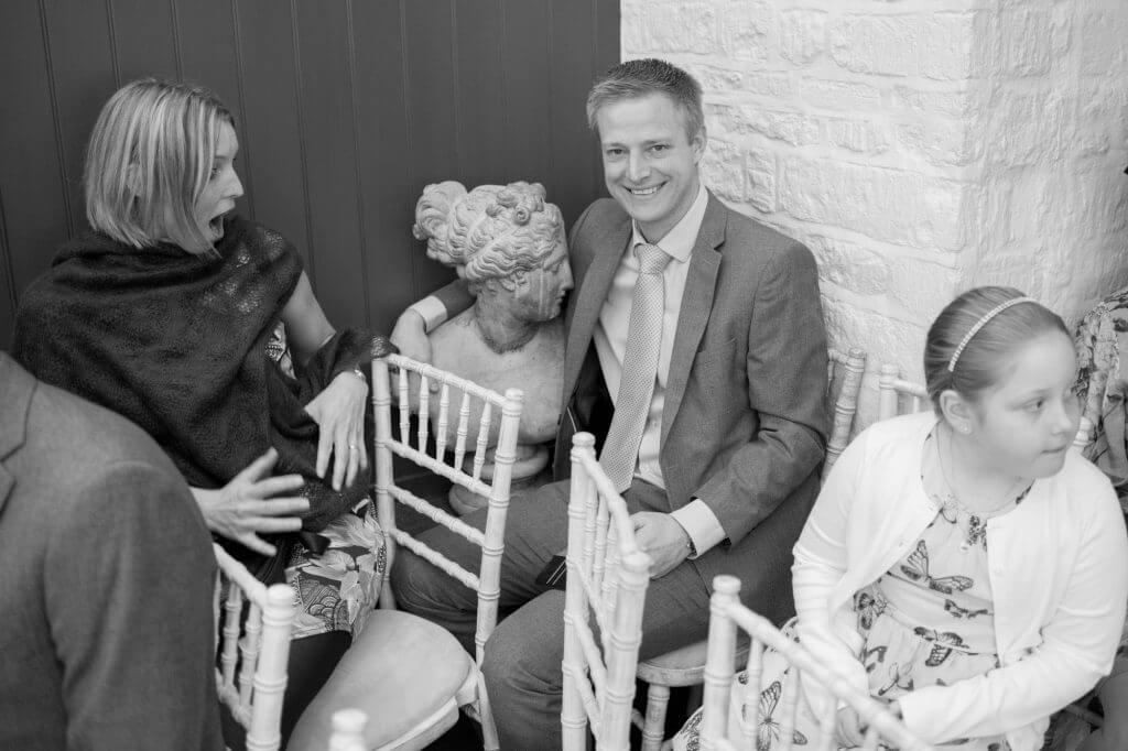 07 Invited guests amused and amazed before marriage ceremony cotswolds bay tree hotel venue burford oxfordshire wedding photography