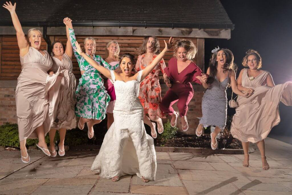 08 bride bridesmaids jump for joy evening reception celebration mythe barn luxury venue leicestershire warwickshire staffordshire oxford wedding photographer