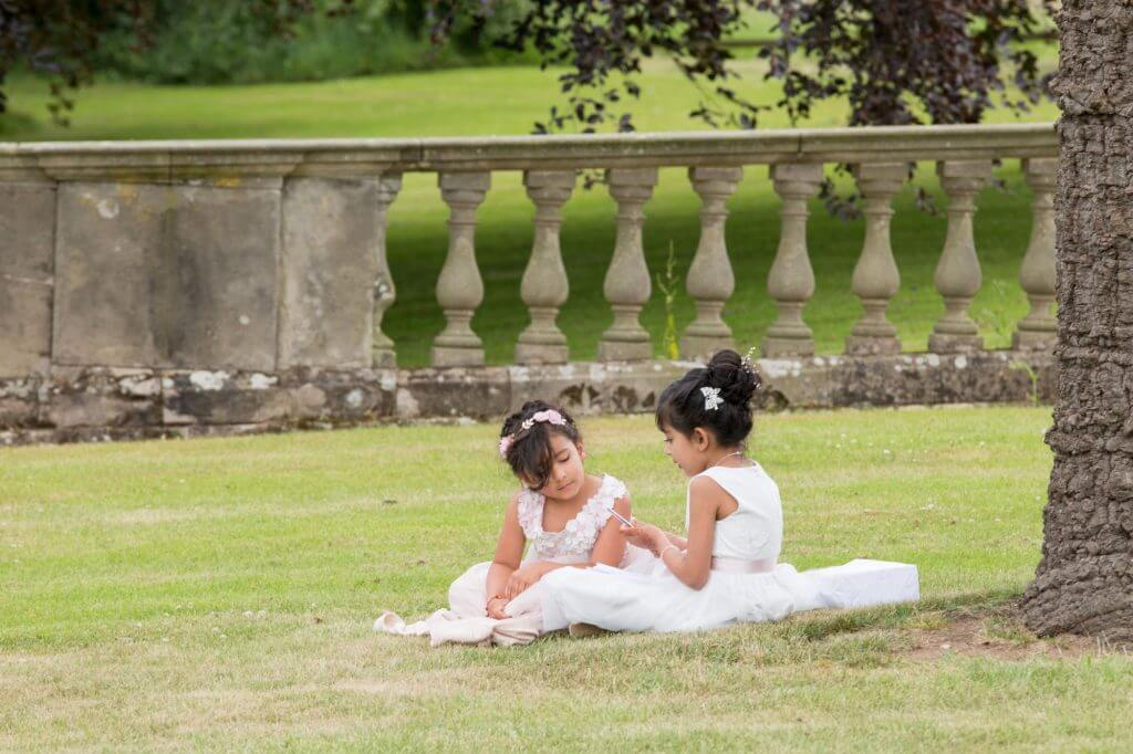 09 young child guests at champagne reception stoneleigh abbey kenilworth warwickshire oxfordshire wedding photographer