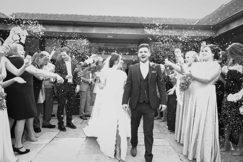 10 bride groom showered with confetti mythe barn luxury venue leicestershire oxfordshire wedding photographer