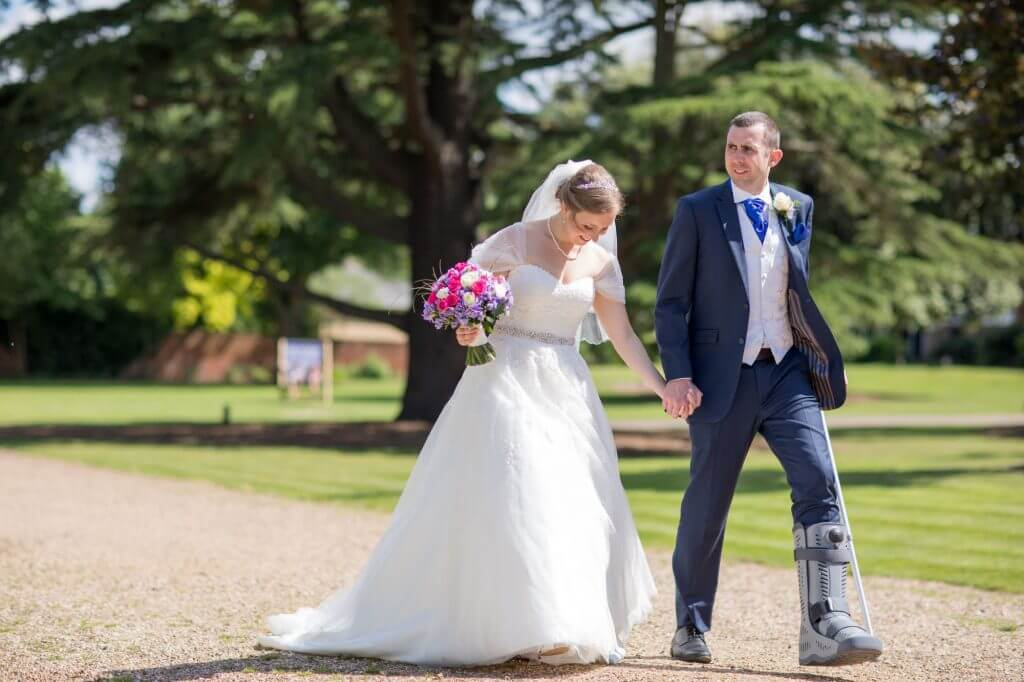 11 bride flowers bouquet groom broken leg crutch de vere beaumont estate venue windsor berkshire oxfordshire wedding photograph