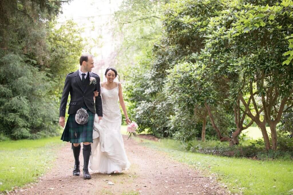 11 bride groom alone walking in grounds of stoneleigh abbey kenilworth warwickshire oxfordshire wedding photography