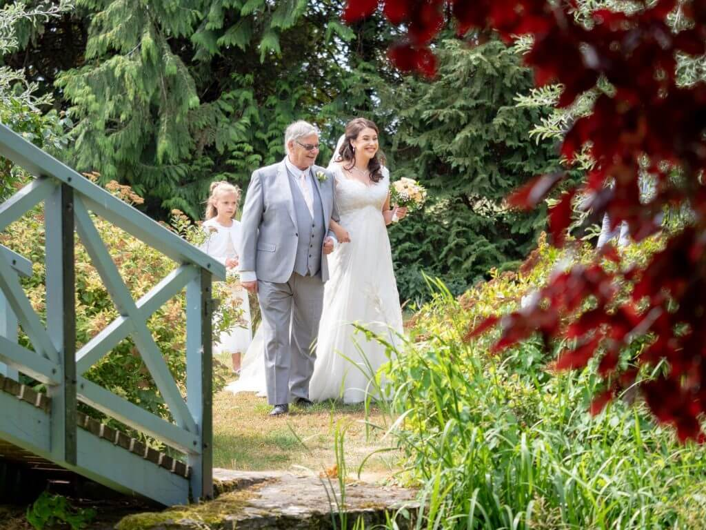 12 bride father of the bride young bridesmaids pre outdoor marriage ceremony oxford wedding photography