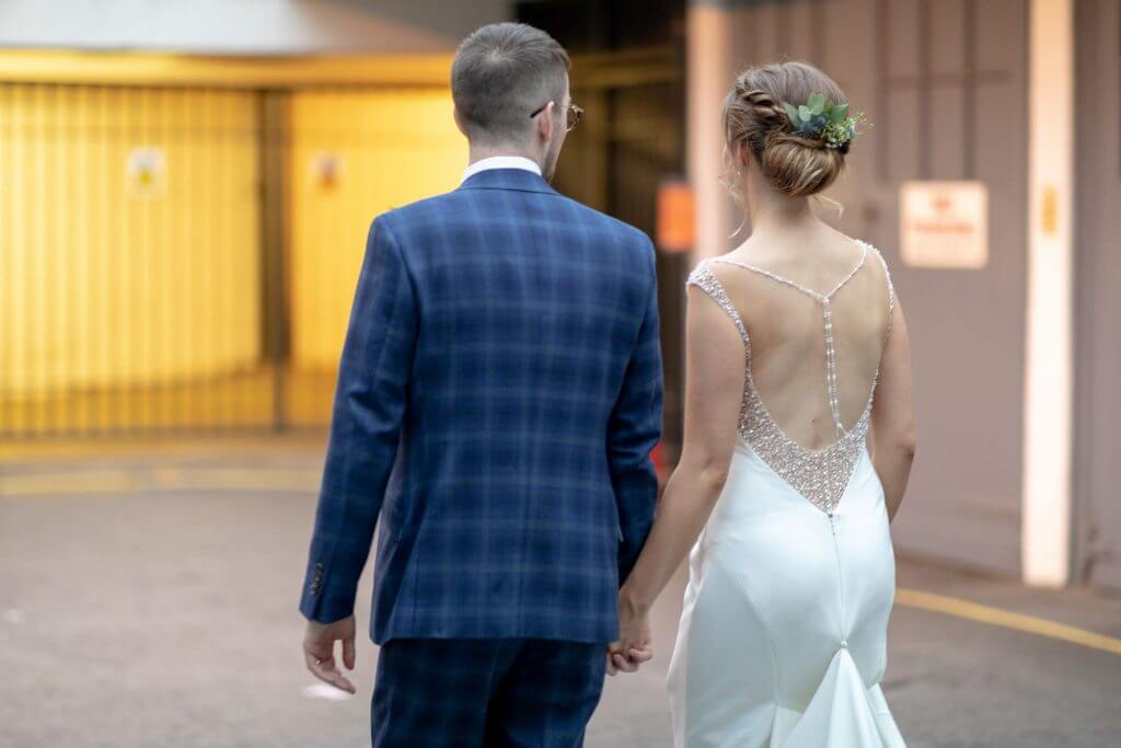 12 bride open back dress and groom hold hands in marylebone street near st marys church bryanston square london oxfordshire wedding photographer