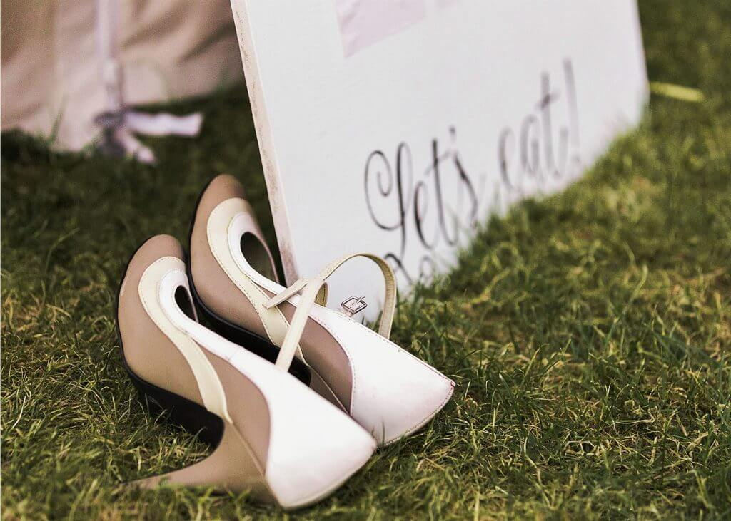 12 guests shoes at luxury marquee dinner reception oxfordshire wedding photography