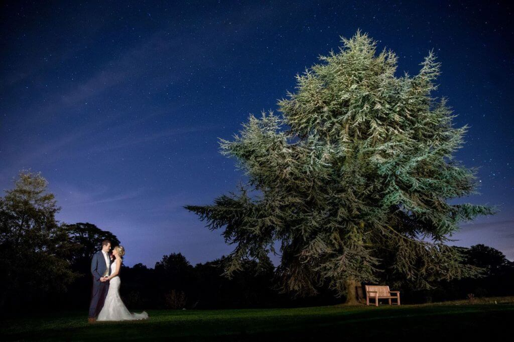 13 bride groom pose traditional family portrait against starlight sky srurwin wedding photography oxford oxfordshire