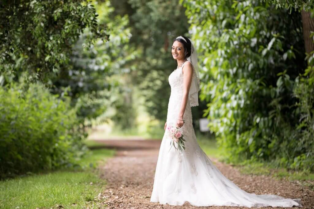 13 bride poses for traditional family portrait stoneleigh abbey kenilworth warwickshire oxfordshire wedding photography