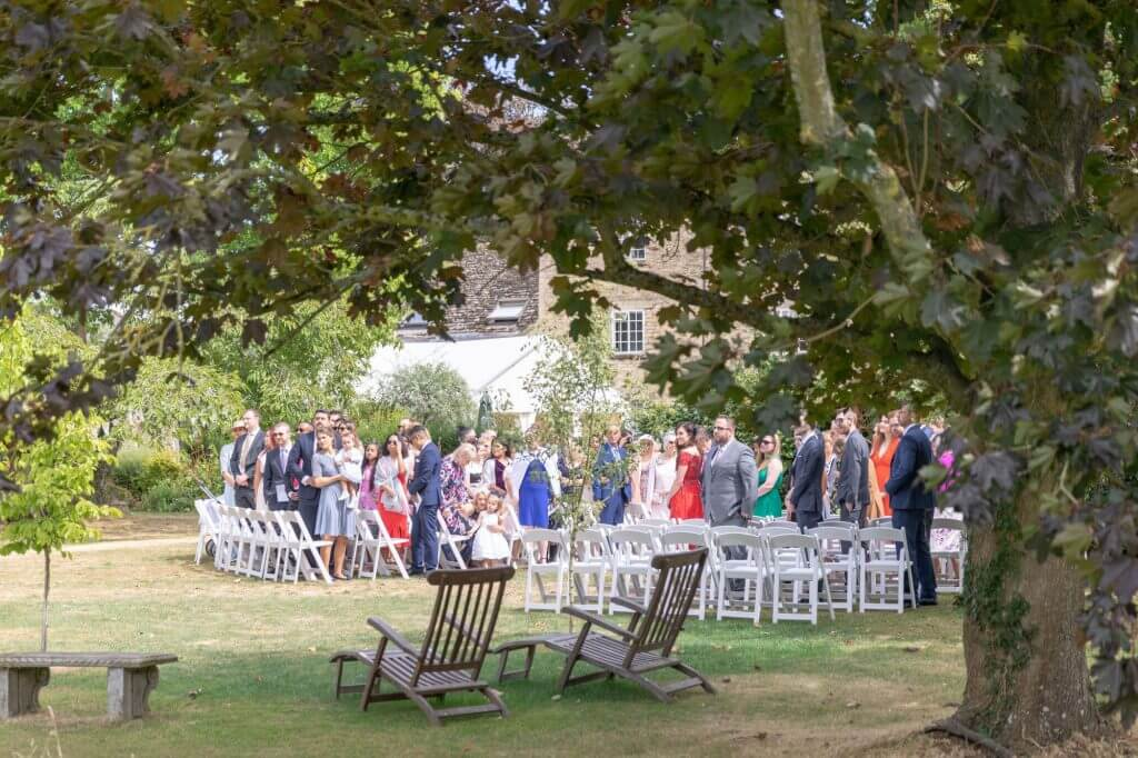13 open air marraige ceremony guests awaiting bride oxford wedding photography