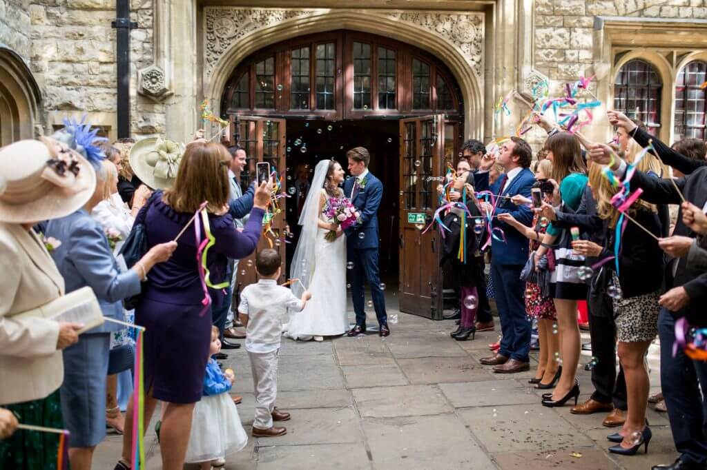 14 bride groom guests blow bubbles after marriage ceremony museum of the order of st john clerkenwell london oxford wedding photographer
