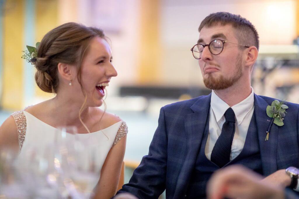 14 laughing bride groom seated dinner reception following marriage ceremony st marys church bryanston square london venue oxfordshire wedding photography