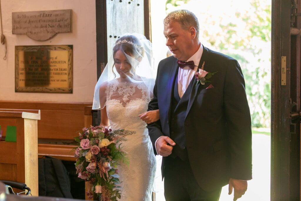 15 bride and father of the bride walking down the aisle iffley church oxford wedding photography