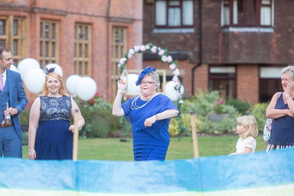 15 invited guest blue dress hat coconut shy after marriage ceremony reception stately home venue oxfordshire wedding photography