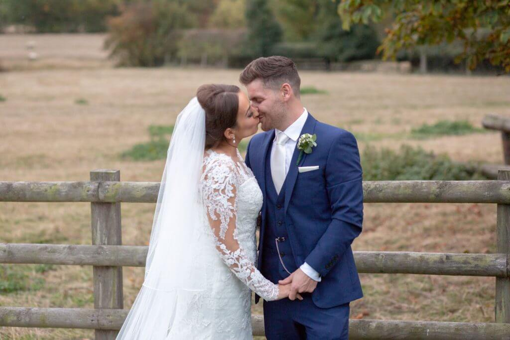 16 bride groom kiss mythe barn luxury venue leicestershire oxfordshire wedding photography