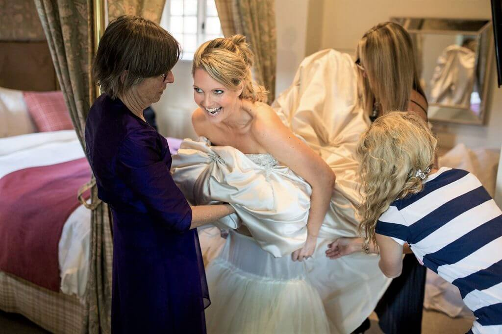 16 bride preparation dress petticoat hotel room before marriage ceremony oxfordshire wedding photography