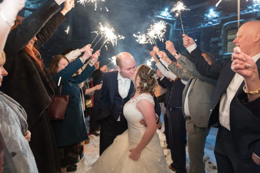 17 bride groom kiss on sparkler departure berkeley castle stately home venue gloucestershire oxfordshire wedding photography