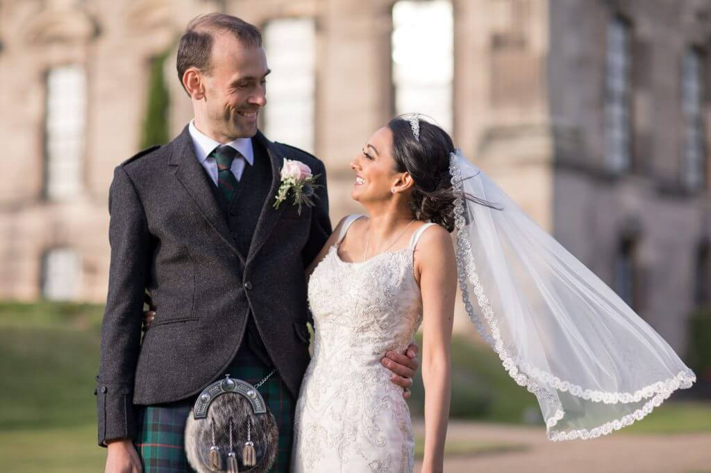 18 bride flowing veil and groom traditional scottish dresss stoneleigh abbey warwickshire oxfordshire wedding photography
