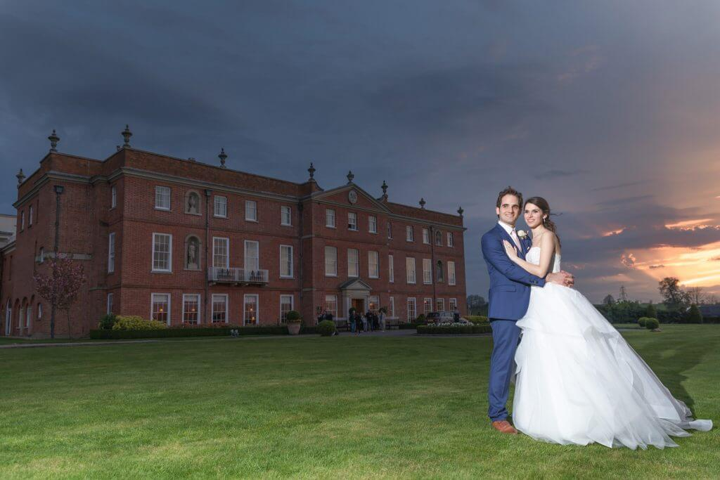 18 bride groom against stunning evening sunset four seasons hotel hampshire venue oxfordshire wedding photographer