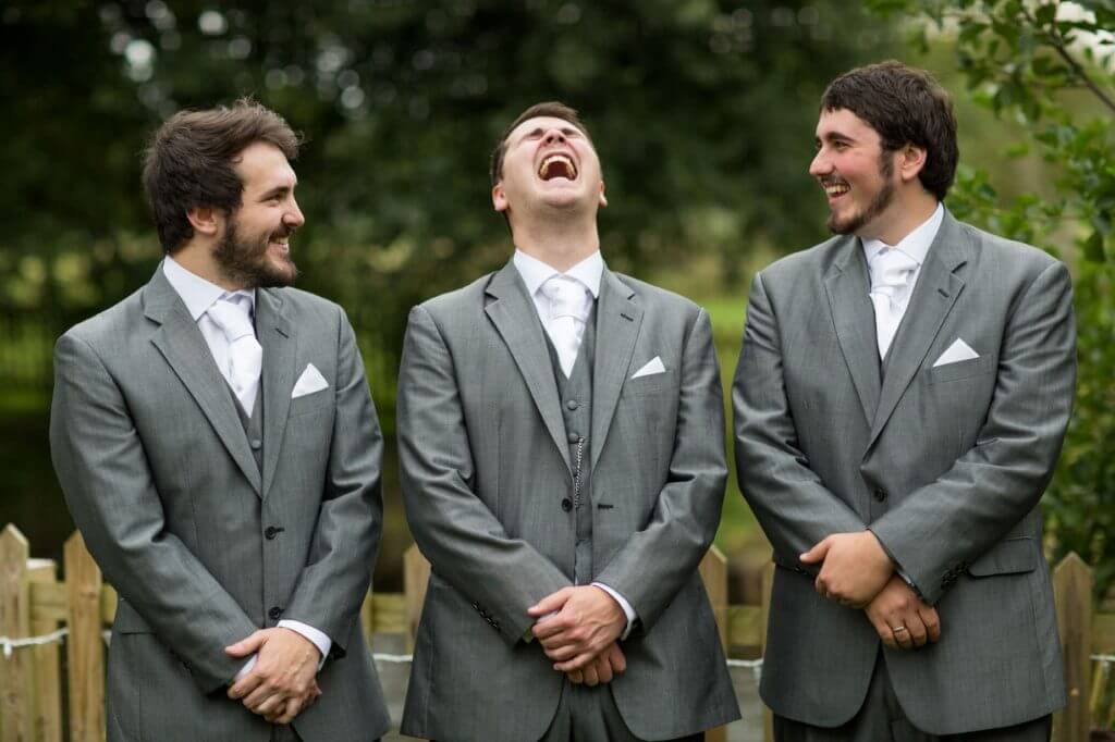 19 groom laughing with groomsmen before marriage ceremony oxfordshire wedding photography