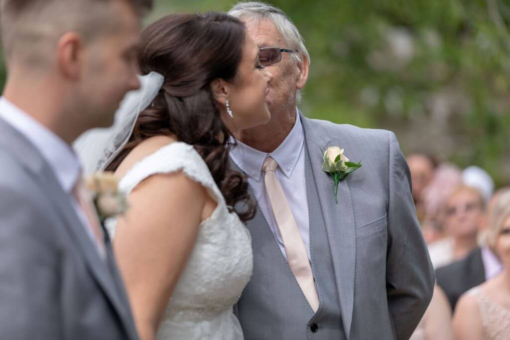 22 father of the bride kissing bride summer garden marriage ceremony oxford wedding photography