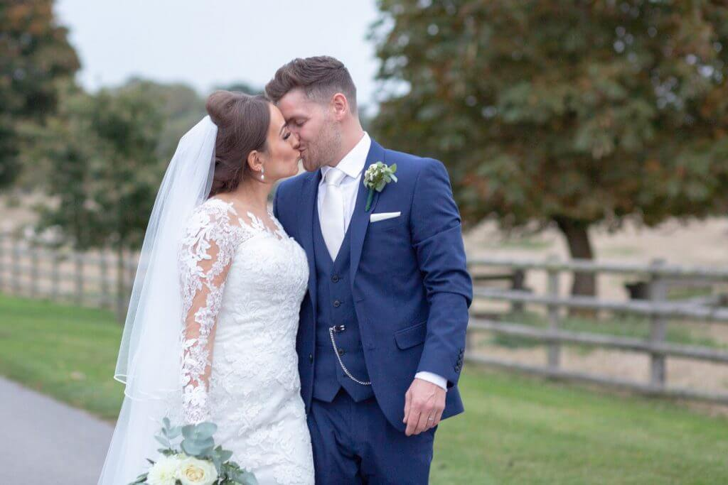25 bride groom kiss in grounds of mythe barn luxury venue leicestershire oxford wedding photographer