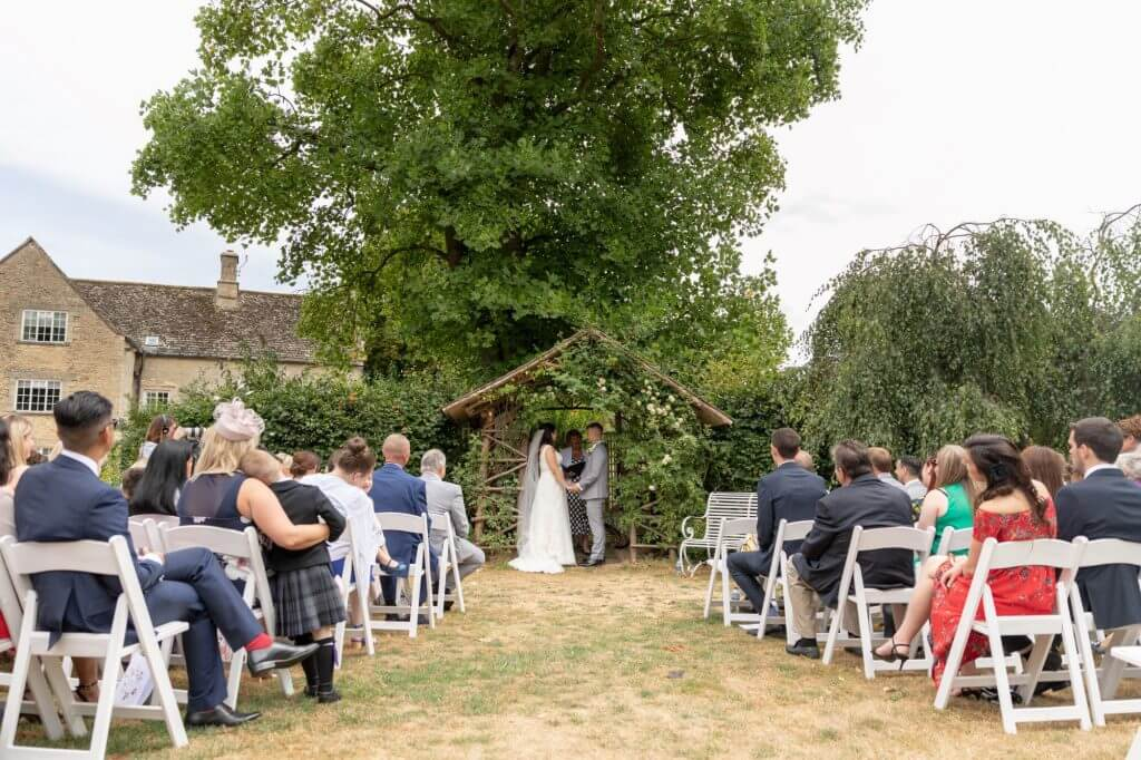 26 bride groom getting married summer garden ceremony oxfordshire wedding photography