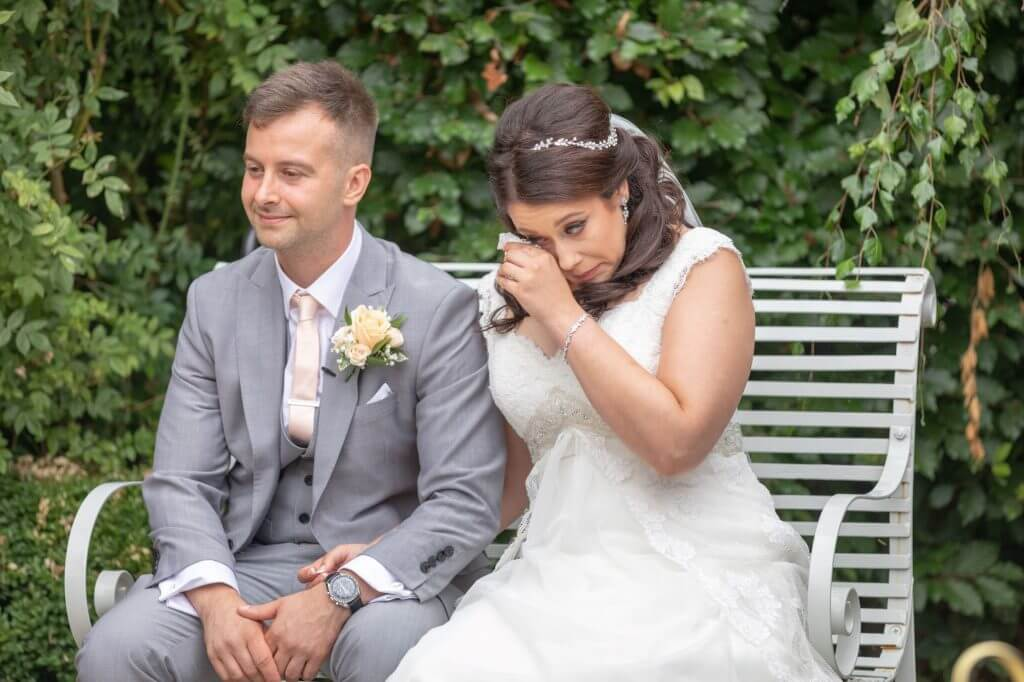 27 bride wipes away tear outdoor marriage ceremony oxfordshire wedding photography