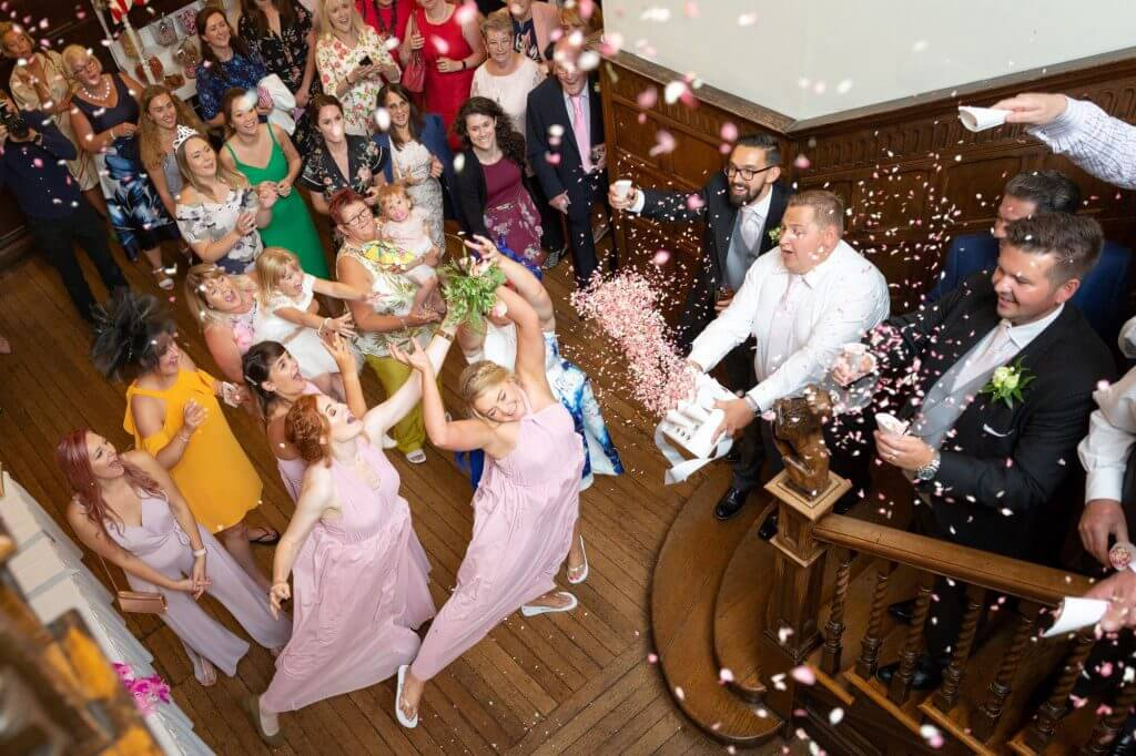 27 bridesmaid catches brides flowers bouquet and showered in confetti celebration party reception oxfordshire wedding photography