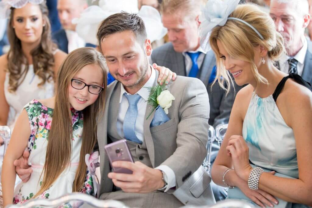 27 marriage ceremony guests take selfie de vere beaumont estate venue windsor berkshire oxfordshire wedding photography
