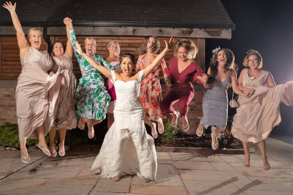 28 bride bridesmaid guests jump for joy evening party celebration mythe barn luxury venue leicestershire oxford wedding photographer
