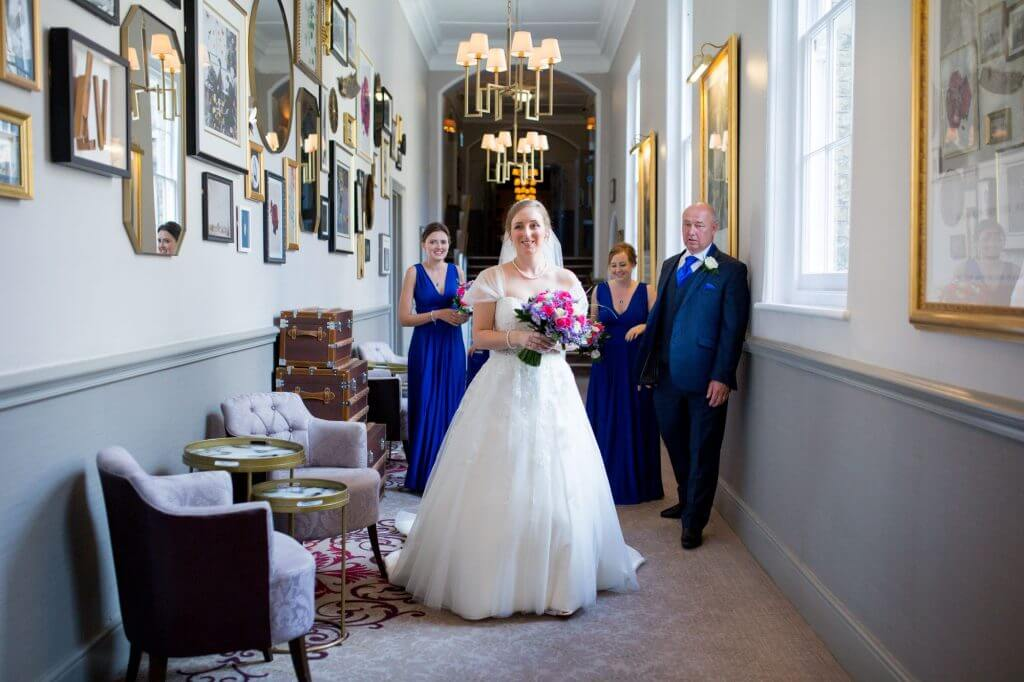 28 father of the bride with daughter and bridesmaids de vere beaumont estate venue windsor berkshire oxfordshire wedding photographer