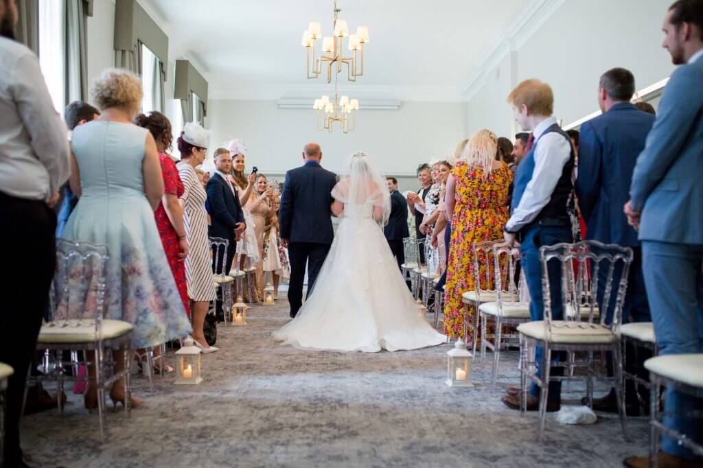 29 father of the bride gives away daughter marriage ceremony de vere beaumont estate windsor berkshire oxfordshire wedding photography