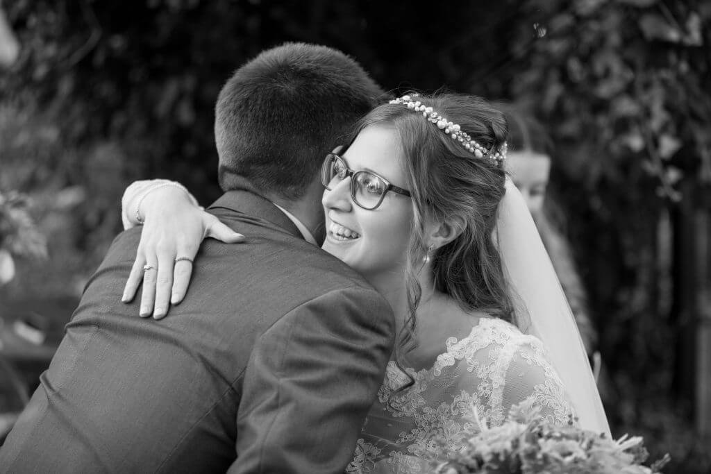 31 bride just married hugs guest the great barn headstone manor harrow middlesex oxford wedding photography