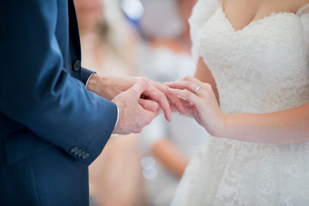 33 bride groom exchange rings marriage ceremony de vere beaumont estate windsor berkshire oxfordshire wedding photography