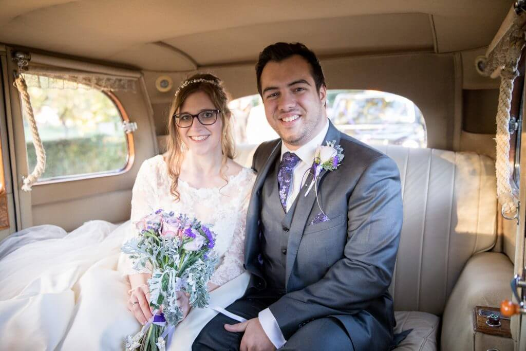 33 bride with flowers bouquet and groom in vintage rolls royce bridal car middlesex oxford wedding photographer
