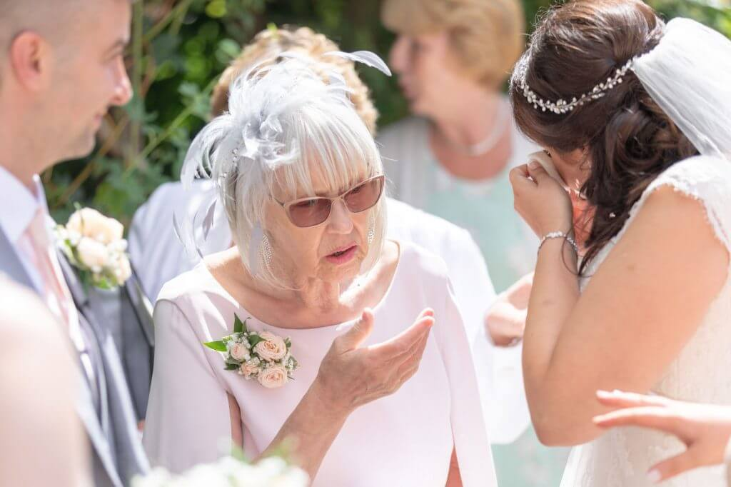 33 tearful bride groom family member summer garden reception venue oxford wedding photography
