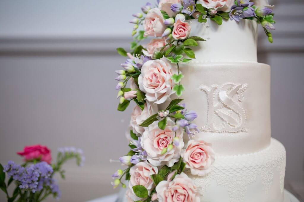 36 cake with roses icing reception dinner de vere beaumont estate venue windsor berkshire oxfordshire wedding photography