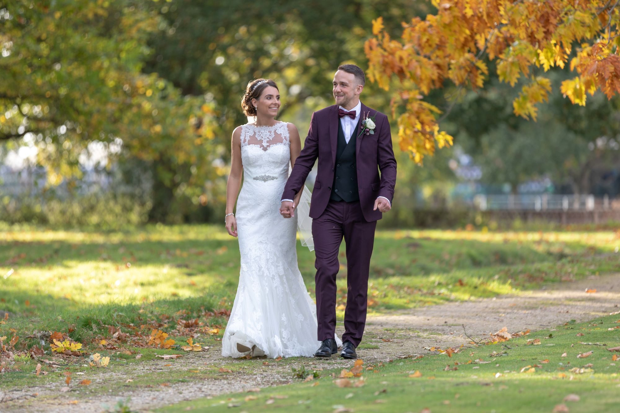 36 just married couple stroll in milton hill house grounds steventon oxfordshire wedding photography